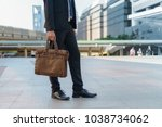 businessman walking in the city ... | Shutterstock . vector #1038734062