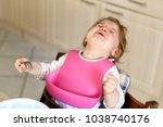 sad crying baby girl. toddler... | Shutterstock . vector #1038740176