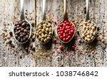 peppers on wooden board | Shutterstock . vector #1038746842