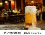 Mug With Beer On The Backgroun...