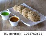wheat rava idli or broken wheat ... | Shutterstock . vector #1038763636
