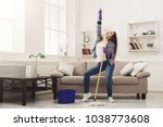 happy woman cleaning home ... | Shutterstock . vector #1038773608