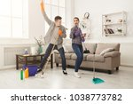 young couple cleaning home ... | Shutterstock . vector #1038773782