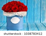 red roses flowers in a blue box ...   Shutterstock . vector #1038783412