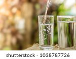 pouring fresh water on drinking ... | Shutterstock . vector #1038787726
