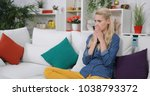 sad woman zapping the remote... | Shutterstock . vector #1038793372