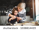 a small girl with grandmother... | Shutterstock . vector #1038814435