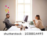 two business people with... | Shutterstock . vector #1038814495