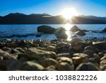 peaceful sunrise and calm lake | Shutterstock . vector #1038822226