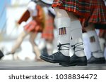 feet in scottish skirts  the... | Shutterstock . vector #1038834472