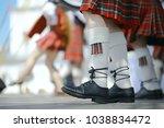 feet in scottish skirts  the... | Shutterstock . vector #1038834472