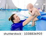 swimming instructor holds the... | Shutterstock . vector #1038836905