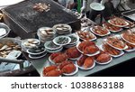 selling seafood on boat at... | Shutterstock . vector #1038863188