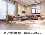 gold table on carpet near grey... | Shutterstock . vector #1038865522