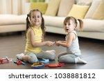 conflict between little sisters ... | Shutterstock . vector #1038881812