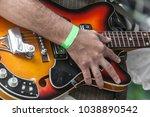 hand of a guitarist resting on... | Shutterstock . vector #1038890542