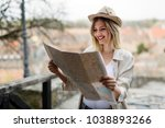 happy female tourist... | Shutterstock . vector #1038893266