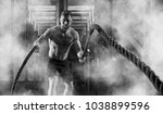 man working out with battle... | Shutterstock . vector #1038899596