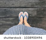 blue shoes isolated on wood... | Shutterstock . vector #1038900496