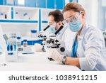selective focus of scientists... | Shutterstock . vector #1038911215