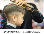 hairdresser's hands making... | Shutterstock . vector #1038920632