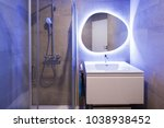 Modern marble bathroom with backlit mirror. Relaxing light. Nobody inside - stock photo