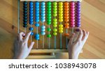 counting colorful abacus | Shutterstock . vector #1038943078