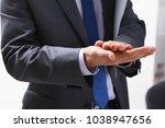 the businessman applauds at a... | Shutterstock . vector #1038947656