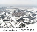 Small photo of Aerial view of the fortified village Naarden Vesting, Holland, after a snow shower. The town has a star shaped pattern. Star fortifications were developed in the late fifteenth centuries.