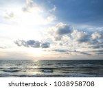 sunset on the tropical beach... | Shutterstock . vector #1038958708