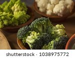 fresh pieces of broccoli ... | Shutterstock . vector #1038975772