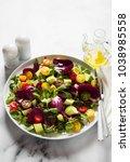 summer bright fresh salad of... | Shutterstock . vector #1038985558