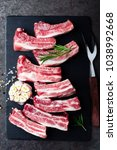 raw uncooked pork ribs  fresh... | Shutterstock . vector #1038992668