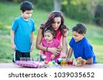 brothers coloring easter eggs | Shutterstock . vector #1039035652