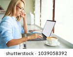 beautiful young freelancer in... | Shutterstock . vector #1039058392