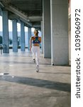back view of female athlete... | Shutterstock . vector #1039060972