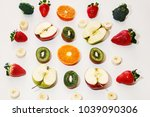 fresh fruits lie on a white... | Shutterstock . vector #1039090306