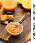 orange jam in bowl with toast...   Shutterstock . vector #1039092985