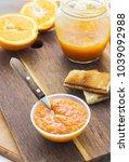 orange jam in bowl with toast...   Shutterstock . vector #1039092988