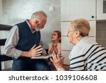 elderly couple showing a photo... | Shutterstock . vector #1039106608