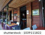 Small photo of GUADELOUPE, CARIBBEAN, FRANCE - FEBRUARY 9, 2018: La Kaz outdoor restaurant in Guadeloupe, Deshaies. Restaurant used in Death In Paradise to double up as Catherine's Bar.