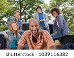 an image of friends on road trip | Shutterstock . vector #1039116382