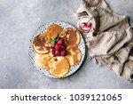 homemade pancakes served on... | Shutterstock . vector #1039121065