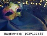 carnival mask background | Shutterstock . vector #1039131658