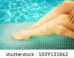 woman shaving legs | Shutterstock . vector #1039131862