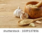 wooden mortar and pestle with...   Shutterstock . vector #1039137856
