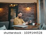 young man sitting in cafeteria... | Shutterstock . vector #1039144528
