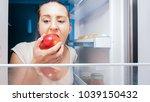young woman sneaking in... | Shutterstock . vector #1039150432