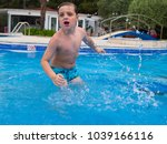 little boy having fun playing... | Shutterstock . vector #1039166116