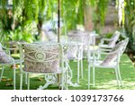 white chair in green garden. | Shutterstock . vector #1039173766